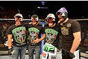 LAS VEGAS, NV - DECEMBER 29:  Erik Perez (second from right) and teammates wearing lucha libre masks at UFC 155 on December 29, 2012 at MGM Grand Garden Arena in Las Vegas, Nevada. (Photo by Donald Miralle/Zuffa LLC/Zuffa LLC via Getty Images) *** Local Caption *** Erik Perez; Byron Bloodworth