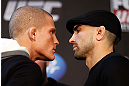CHICAGO, IL - JANUARY 24:  (L-R) Opponents Erik Koch and Ricardo Lamas face off during the UFC on FOX press conference on January 24, 2013 at the United Center in Chicago, Illinois. (Photo by Josh Hedges/Zuffa LLC/Zuffa LLC via Getty Images)