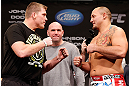 CHICAGO, IL - JANUARY 25:  (L-R) Opponents Mike Russow and Shawn Jordan face off during the UFC on FOX weigh-in on January 25, 2013 at the Chicago Theatre in Chicago, Illinois. (Photo by Josh Hedges/Zuffa LLC/Zuffa LLC via Getty Images)