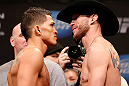 "CHICAGO, IL - JANUARY 25:  (L-R) Opponents Anthony Pettis and Donald ""Cowboy"" Cerrone face off during the UFC on FOX weigh-in on January 25, 2013 at the Chicago Theatre in Chicago, Illinois. (Photo by Josh Hedges/Zuffa LLC/Zuffa LLC via Getty Images)"