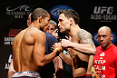 LAS VEGAS, NV - FEBRUARY 01:  (L-R) Opponents Jose Aldo and Frankie Edgar face off during the UFC 156 weigh-in on February 1, 2013 at Mandalay Bay Events Center in Las Vegas, Nevada.  (Photo by Josh Hedges/Zuffa LLC/Zuffa LLC via Getty Images)