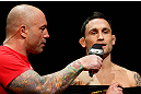 LAS VEGAS, NV - FEBRUARY 01:  (R-L) Frankie Edgar is interviewed by Joe Rogan during the UFC 156 weigh-in on February 1, 2013 at Mandalay Bay Events Center in Las Vegas, Nevada.  (Photo by Josh Hedges/Zuffa LLC/Zuffa LLC via Getty Images)