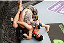 LONDON, ENGLAND - FEBRUARY 16:  (R-L) Josh Grispi attempts a triangle choke against Andy Ogle in their featherweight fight during the UFC on Fuel TV event on February 16, 2013 at Wembley Arena in London, England.  (Photo by Josh Hedges/Zuffa LLC/Zuffa LLC via Getty Images)