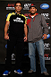 ANAHEIM, CA - FEBRUARY 21:  (L-R) Opponents Lyoto Machida and Dan Henderson pose for photos during a UFC pre-fight press conference at Honda Center on February 21, 2013 in Anaheim, California.  (Photo by Josh Hedges/Zuffa LLC/Zuffa LLC via Getty Images)
