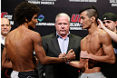 SAITAMA, JAPAN - MARCH 02: (L-R) Opponents Alex Caceres and Kyung Ho Kang face off during the UFC on FUEL TV weigh-in at Saitama Super Arena on March 2, 2013 in Saitama, Japan. (Photo by Josh Hedges/Zuffa LLC/Zuffa LLC via Getty Images)