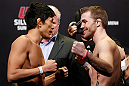 SAITAMA, JAPAN - MARCH 02: (L-R) Opponents Takeya Mizugaki and Bryan Caraway face off during the UFC on FUEL TV weigh-in at Saitama Super Arena on March 2, 2013 in Saitama, Japan. (Photo by Josh Hedges/Zuffa LLC/Zuffa LLC via Getty Images)