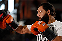 MONTREAL, QC - MARCH 13:  Johny Hendricks conducts an open training session for fans and media ahead of his UFC 158 bout at Complexe Desjardins on March 13, 2013 in Montreal, Quebec, Canada.  (Photo by Josh Hedges/Zuffa LLC/Zuffa LLC via Getty Images)