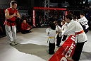 MONTREAL, QC - MARCH 13:  UFC welterweight champion Georges St-Pierre (2L) watches a demonstration by students of the Sunfuki Karate school during the UFC 158 open workouts at Complexe Desjardins on March 13, 2013 in Montreal, Quebec, Canada.  (Photo by Josh Hedges/Zuffa LLC/Zuffa LLC via Getty Images)