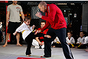 MONTREAL, QC - MARCH 13:  UFC welterweight champion Georges St-Pierre (R) spars with students of the Sunfuki Karate school during the UFC 158 open workouts at Complexe Desjardins on March 13, 2013 in Montreal, Quebec, Canada.  (Photo by Josh Hedges/Zuffa LLC/Zuffa LLC via Getty Images)