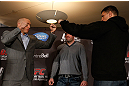 MONTREAL, QC - MARCH 14:  (L-R) Opponents Georges St-Pierre and Nick Diaz face off during the final press conference ahead of his UFC 158 bout at Bell Centre on March 14, 2013 in Montreal, Quebec, Canada.  (Photo by Josh Hedges/Zuffa LLC/Zuffa LLC via Getty Images)