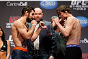 MONTREAL, QC - MARCH 15:  (L-R) Antonio Carvalho faces off with Darren Elkins during the UFC 158 weigh-in at Bell Centre on March 15, 2013 in Montreal, Quebec, Canada.  (Photo by Josh Hedges/Zuffa LLC/Zuffa LLC via Getty Images)