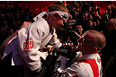 MONTREAL, QC - MARCH 16:  Georges St-Pierre greets a young fan on his way out of the arena after his victory over Nick Diaz in their welterweight championship bout during the UFC 158 event at Bell Centre on March 16, 2013 in Montreal, Quebec, Canada.  (Photo by Jonathan Ferrey/Zuffa LLC/Zuffa LLC via Getty Images)