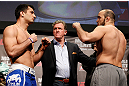 STOCKHOLM, SWEDEN - APRIL 05:  (L-R) Opponents Gegard Mousasi and Ilir Latifi face off during the UFC weigh-in at the Ericsson Globe Arena on April 5, 2013 in Stockholm, Sweden.  (Photo by Josh Hedges/Zuffa LLC/Zuffa LLC via Getty Images)