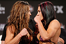 LAS VEGAS, NV - APRIL 12: (L-R) Opponents Miesha Tate and Cat Zingano face off during the TUF 17 Finale weigh-in at the Hollywood Theatre at the MGM Grand Hotel/Casino on April 12, 2013 in Las Vegas, Nevada. (Photo by Josh Hedges/Zuffa LLC/Zuffa LLC via Getty Images)
