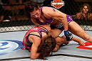 LAS VEGAS, NV - APRIL 13:   Cat Zingano (top) punches Miesha Tate in their bantamweight fight at the Mandalay Bay Events Center  on April 13, 2013 in Las Vegas, Nevada.  (Photo by Josh Hedges/Zuffa LLC/Zuffa LLC via Getty Images)  *** Local Caption *** Miesha Tate; Cat Zingano