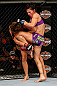 LAS VEGAS, NV - APRIL 13:   Cat Zingano (right) knees Miesha Tate in their bantamweight fight at the Mandalay Bay Events Center  on April 13, 2013 in Las Vegas, Nevada.  (Photo by Josh Hedges/Zuffa LLC/Zuffa LLC via Getty Images)  *** Local Caption *** Miesha Tate; Cat Zingano