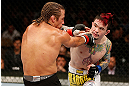 LAS VEGAS, NV - APRIL 13:   (R-L) Scott Jorgensen punches Urijah Faber in their bantamweight fight at the Mandalay Bay Events Center  on April 13, 2013 in Las Vegas, Nevada.  (Photo by Josh Hedges/Zuffa LLC/Zuffa LLC via Getty Images)  *** Local Caption *** Urijah Faber; Scott Jorgensen