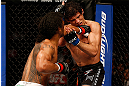 SAN JOSE, CA - APRIL 20:   (L-R) Benson Henderson punches Gilbert Melendez in their lightweight championship bout during the UFC on FOX event during the UFC on FOX event at the HP Pavilion on April 20, 2013 in San Jose, California.  (Photo by Josh Hedges/Zuffa LLC/Zuffa LLC via Getty Images)  *** Local Caption *** Benson Henderson; Gilbert Melendez