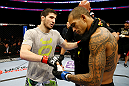 NEWARK, NJ - APRIL 27:  (L-R) Rustam Khabilov of Russia shakes hands with Yancy Medeiros after winning by TKO (Thumb Injury) during their lightweight bout during the UFC 159 event at the Prudential Center on April 27, 2013 in Newark, New Jersey.  (Photo by Al Bello/Zuffa LLC/Zuffa LLC Via Getty Images)