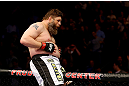 NEWARK, NJ - APRIL 27:  Roy Nelson sits on the side of the octagon in celebration of his win by knockout against Cheick Kongo of France in their heavyweight bout during the UFC 159 event at the Prudential Center on April 27, 2013 in Newark, New Jersey.  (Photo by Al Bello/Zuffa LLC/Zuffa LLC Via Getty Images)