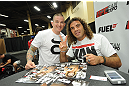 LAS VEGAS, NV - JULY 06:  Clay Guida poses with a fan at the UFC Fan Expo on July 6, 2012 in Las Vegas, Nevada. (Photo by Al Powers /Zuffa LLC/Zuffa LLC via Getty Images)