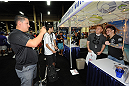 LAS VEGAS, NV - JULY 7:   Scott Jorgensen poses with fans during the UFC Fan Expo at the Mandalay Bay Convention Center on July 7, 2012 in Las Vegas, Nevada.  (Photo by Al Powers/Zuffa LLC/Zuffa LLC via Getty Images)  *** Local Caption ***