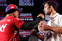 JARAGUA DO SUL, BRAZIL - MAY 16:   (L-R) Opponents Vitor Belfort and Luke Rockhold face off during media day for the UFC on FX event on May 16, 2013 at the Sociedade Cultura Artistica in Jaragua do Sul, Santa Catarina, Brazil.  (Photo by Josh Hedges/Zuffa LLC/Zuffa LLC via Getty Images)