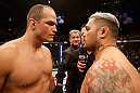 LAS VEGAS, NV - MAY 25:   (L-R) Junior dos Santos and Mark Hunt stare off before  their heavyweight bout during UFC 160 at the MGM Grand Garden Arena on May 25, 2013 in Las Vegas, Nevada.  (Photo by Josh Hedges/Zuffa LLC/Zuffa LLC via Getty Images)  *** Local Caption *** Junior dos Santos; Mark Hunt
