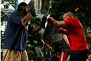 WINNIPEG, CANADA - JUNE 12:  (R-L) Pat Barry works out with former CFL football player Obby Khan during an open workout session for fans and media at Portage Place on June 12, 2013 in Winnipeg, Manitoba, Canada.  (Photo by Josh Hedges/Zuffa LLC/Zuffa LLC via Getty Images)