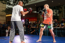WINNIPEG, CANADA - JUNE 12:  (R-L) Shawn Jordan works out with former CFL football player Lamar McGriggs during an open workout session for fans and media at Portage Place on June 12, 2013 in Winnipeg, Manitoba, Canada.  (Photo by Josh Hedges/Zuffa LLC/Zuffa LLC via Getty Images)