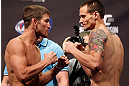 WINNIPEG, CANADA - JUNE 14:  (L-R) Opponents Sam Stout and James Krause face off during the UFC 161 weigh-in at the MTS Centre on June 14, 2013 in Winnipeg, Manitoba, Canada.  (Photo by Josh Hedges/Zuffa LLC/Zuffa LLC via Getty Images)