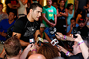 LAS VEGAS, NV - JULY 03:  Chris Weidman interacts with media inside XS The Nightclub at Encore Las Vegas on July 3, 2013 in Las Vegas, Nevada.  (Photo by Josh Hedges/Zuffa LLC/Zuffa LLC via Getty Images)