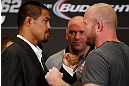 LAS VEGAS, NV - JULY 04:  (L-R) Opponents Mark Munoz and Tim Boetsch face off during the final UFC 162 press conference at the MGM Grand Hotel/Casino on July 4, 2013 in Las Vegas, Nevada.  (Photo by Josh Hedges/Zuffa LLC/Zuffa LLC via Getty Images)
