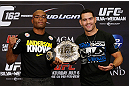LAS VEGAS, NV - JULY 04:  (L-R) Opponents Anderson Silva and Chris Weidman pose for photos during the final UFC 162 press conference at the MGM Grand Hotel/Casino on July 4, 2013 in Las Vegas, Nevada.  (Photo by Josh Hedges/Zuffa LLC/Zuffa LLC via Getty Images)