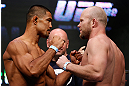 LAS VEGAS, NV - JULY 05:  (L-R) Opponents Mark Munoz and Tim Boetsch face off during the UFC 162 weigh-in at the Mandalay Bay Events Center on July 5, 2013 in Las Vegas, Nevada.  (Photo by Josh Hedges/Zuffa LLC/Zuffa LLC via Getty Images)