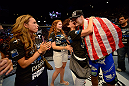 LAS VEGAS, NV - JULY 06:  Chris Weidman (right) celebrates with his family after his victory over Anderson Silva in their UFC middleweight championship fight during the UFC 162 event inside the MGM Grand Garden Arena on July 6, 2013 in Las Vegas, Nevada.  (Photo by Donald Miralle/Zuffa LLC/Zuffa LLC via Getty Images) *** Local Caption *** Anderson Silva; Chris Weidman