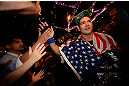 LAS VEGAS, NV - JULY 06:  Chris Weidman with fans after his victory over Anderson Silva in their UFC middleweight championship fight during the UFC 162 event inside the MGM Grand Garden Arena on July 6, 2013 in Las Vegas, Nevada.  (Photo by Donald Miralle/Zuffa LLC/Zuffa LLC via Getty Images) *** Local Caption *** Anderson Silva; Chris Weidman