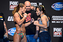 SEATTLE, WA - JULY 26:  Opponents Liz Carmouche (L) and Jessica Andrade face off during the official UFC on FOX weigh-in at Key Arena on July 26, 2013 in Seattle, Washington.  (Photo by Jeff Bottari/Zuffa LLC/Zuffa LLC via Getty Images)