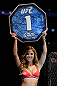 SEATTLE, WA - JULY 27: UFC Octagon Girl Brittney Palmer introduces round one of Kedzie vs de Randamie before their bantamweight bout during the UFC on FOX event at Key Arena on July 27, 2013 in Seattle, Washington. (Photo by Jeff Bottari/Zuffa LLC/Zuffa LLC via Getty Images) *** Local Caption *** Brittney Palmer