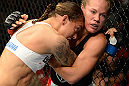 SEATTLE, WA - JULY 27: Germaine de Randamie (left) and Julie Kedzie grapple against the Octagon in their bantamweight bout during the UFC on FOX event at Key Arena on July 27, 2013 in Seattle, Washington. (Photo by Jeff Bottari/Zuffa LLC/Zuffa LLC via Getty Images) *** Local Caption *** Julie Kedzie; Germaine de Randamie