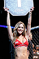 SEATTLE, WA - JULY 27:  UFC Octagon Girl Brittney Palmer introduces round one of Edwards vs Cruickshank in their lightweight bout during the UFC on FOX event at Key Arena on July 27, 2013 in Seattle, Washington. (Photo by Josh Hedges/Zuffa LLC/Zuffa LLC via Getty Images) *** Local Caption *** Brittney Palmer