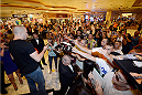 LAS VEGAS, NV - JULY 29:  UFC welterweight champion Georges St-Pierre interacts with fans during the UFC World Tour 2013 press conference in the lobby of the MGM Grand Hotel/Casino on July 29, 2013 in Las Vegas, Nevada. Georges St-Pierre will defend the UFC welterweight championship against Johny Hendricks November 16th at UFC 167 in Las Vegas.  (Photo by Jeff Bottari/Zuffa LLC/Zuffa LLC via Getty Images)
