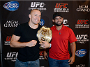 LAS VEGAS, NV - JULY 29:  UFC welterweight champion Georges St-Pierre (L) and Johny Hendricks square off for the media during the UFC World Tour 2013 press conference in the lobby of the MGM Grand Hotel/Casino on July 29, 2013 in Las Vegas, Nevada. Georges St-Pierre will defend the UFC welterweight championship against Johny Hendricks November 16th at UFC 167 in Las Vegas.  (Photo by Jeff Bottari/Zuffa LLC/Zuffa LLC via Getty Images)