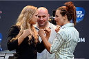 LOS ANGELES, CA - JULY 30:  UFC president Dana White (C) hosts a press conference live with UFC women's bantamweight champion Ronda Rousey (L) and Miesha Tate (R) during the UFC World Tour 2013 at Club Nokia at L.A. Live on July 30, 2013 in Los Angeles, California. Ronda Rousey will defend the UFC women's bantamweight championship against Miesha Tate December 28th at UFC 168 in Las Vegas.  (Photo by Jeff Bottari/Zuffa LLC/Zuffa LLC via Getty Images)