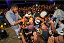 LOS ANGELES, CA - JULY 30:  UFC light heavyweight champion Jon Jones interacts with fans during the UFC World Tour 2013 at Club Nokia at L.A. Live on July 30, 2013 in Los Angeles, California.  (Photo by Jeff Bottari/Zuffa LLC/Zuffa LLC via Getty Images)