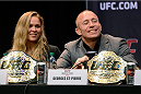 LOS ANGELES, CA - JULY 30:  UFC welterweight champion Georges St-Pierre (R) interacts with the media sitting next to UFC women's bantamweight champion Ronda Rousey (L) during the UFC World Tour 2013 press conference at Club Nokia at L.A. Live on July 30, 2013 in Los Angeles, California.  (Photo by Jeff Bottari/Zuffa LLC/Zuffa LLC via Getty Images)