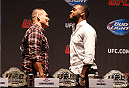 NEW YORK, NY - JULY 31:  (L-R) UFC heavyweight champion Cain Velasquez and UFC light heavyweight champion Jon Jones face-off during a press conference at Beacon Theatre on July 31, 2013 in New York City.  (Photo by Mike Stobe/Zuffa LLC/Zuffa LLC via Getty Images)
