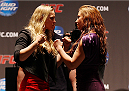 NEW YORK, NY - JULY 31:  (L-R) UFC women's bantamweight champion Ronda Rousey and Miesha Tate face-off at the Beacon Theatre on July 31, 2013 in New York City.  (Photo by Mike Stobe/Zuffa LLC/Zuffa LLC via Getty Images)