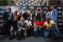 MONTREAL, CANADA - AUGUST 1: (From top left to right) Patrick Cote, Charles Hamelin, Mariane St-Gelais, Antoine Valois-Fortier, Nicholas Gill, Mike Ricci, Mathieu Dandault, Bermane Stiverne, Lucien Bute, Sergio Pessoa, George St Pierre, Yves Jabouin, John Makdessi, Johny Hendricks and Adonis Stevenson poses for a group photo during the Georges St Pierre and Johny Hendricks Press Tour on August 1, 2013 in Montreal, Quebec, Canada. (Francois Laplante/Zuffa LLC via Getty Images)