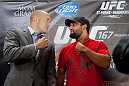 MONTREAL, CANADA - AUGUST 1: Georges St Pierre and Johny Hendricks squares during the Georges St Pierre and Johny Hendricks Press Tour on August 1, 2013 in Montreal, Quebec, Canada. (Francois Laplante/Zuffa LLC via Getty Images)